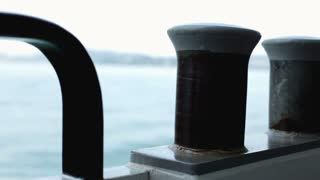 Boat tie up post with water in background