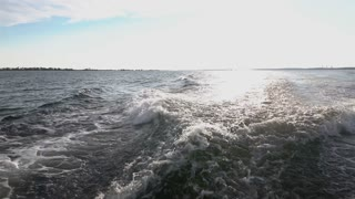 Boat waves with horizon in background slow motion