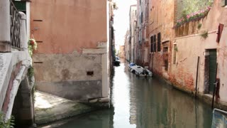 Boats in canals of Venice Italy