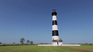 Bodie Island Light station with people visiting