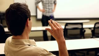 Bored student flicking pen while someone talks