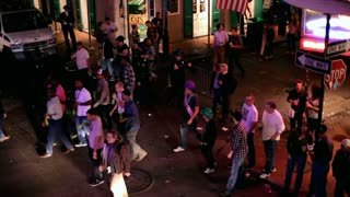 Bourbon street with many people mardi gras 2012