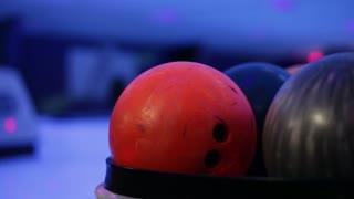 Bowling balls at lanes of lunar bowl