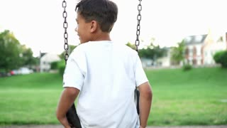Boy and family at playground in park 4k