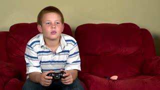 Boy anonymously playing online video games