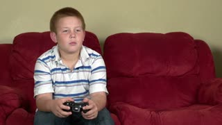 Boy gets upset playing video game
