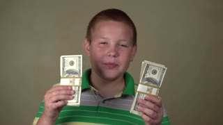 Boy Holding Cash looking serious