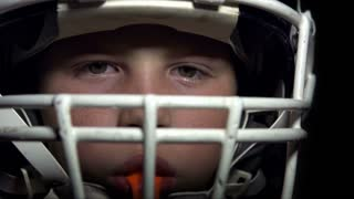Boy in Football gear looking at camera