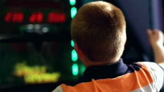 Boy playing basketball arcade over the shoulder