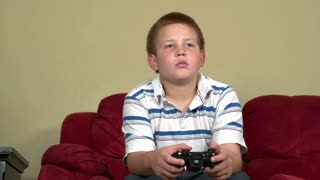 Boy playing video games slider shot part 1