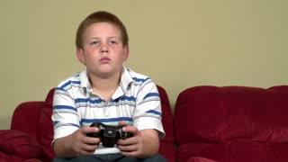 Boy playing video games slider shot part 2