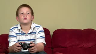 Boy playing video games slider shot part 3