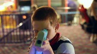 Boy pointing Video Game Gun at Camera