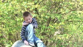 Boy Posing on Rock for Picture