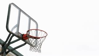Brick shot on outdoor basketball hoop