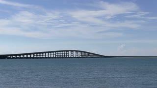 Bridge spanning across ocean water
