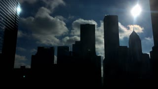 Bright sunshine with silhouette of Chicago buildings 4k