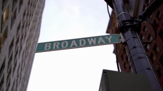 Broadway city street sign in downtown area 4k