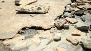 Broken tile and rock debris dolly shot