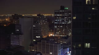Brooklyn cityscape at night with Statue of Liberty in background 4k