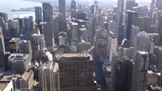 Buildings in city of Chicago seen from high above slow motion