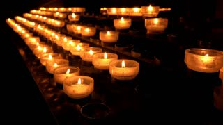 Burning candles in church as a memorial 4k