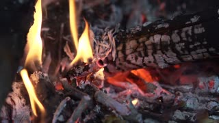 Burning pile of wood in slow motion