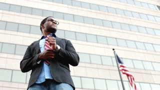Businessman and Building with American Flag