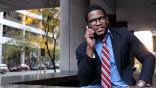 Businessman in City talking on Cell Phone