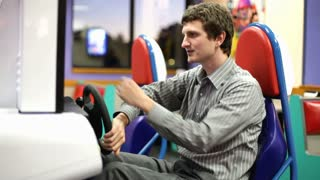 Businessman playing Arcade Racing Game