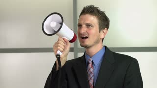 Businessman recruiting people with mega phone