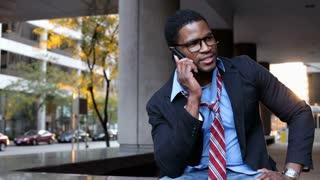 Businessman relaxing having phone conversation