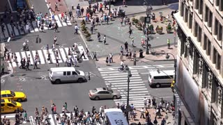 Busy downtown New York intersection with people crossing street aerial view 4k