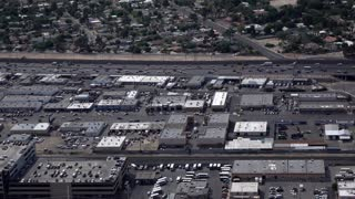 Busy highway and city streets below in Las Vegas 4k