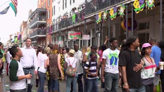 Busy streets of Bourbon during Mardi Gras handheld