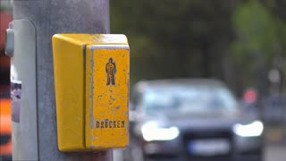 Button pressed for cross walk signal by hand 4k