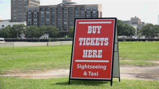 Buy tickets here sign for boat sightseeing ride 4k