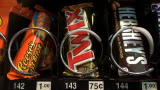 Buying Twix from Snack machine
