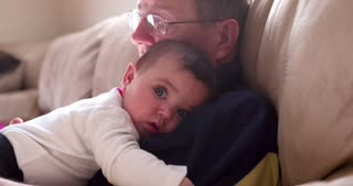 Calm baby laying on Grandpa 4k