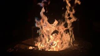 Camp fire burning in backyard pit 4k