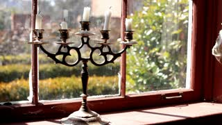 Candle stick sitting in window