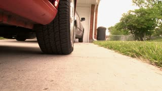Car Backing up from Tire View