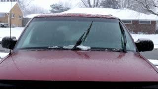 Car sitting outside in sleet storm