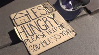 Cardboard sign of someone who is homeless and hungry 4k