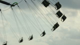 Carnival swings with sky in background