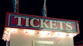 Carnival ticket booth at night