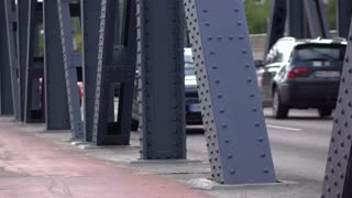 Cars crossing bridge with focus on structure 4k