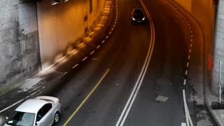 Cars exiting and entering tunnel