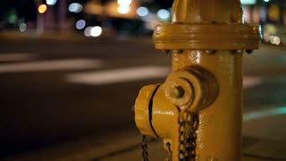 Cars Passing Fire Hydrant at Night
