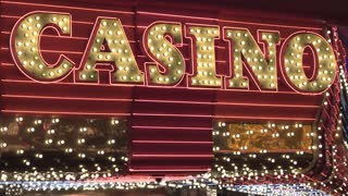 Casino billboard lights flashing on gambling facility 4k